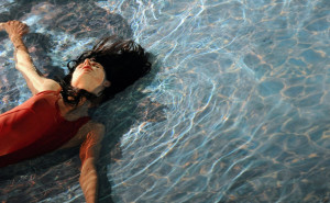 """A dancer perfoms in the play """"Swimming p"""
